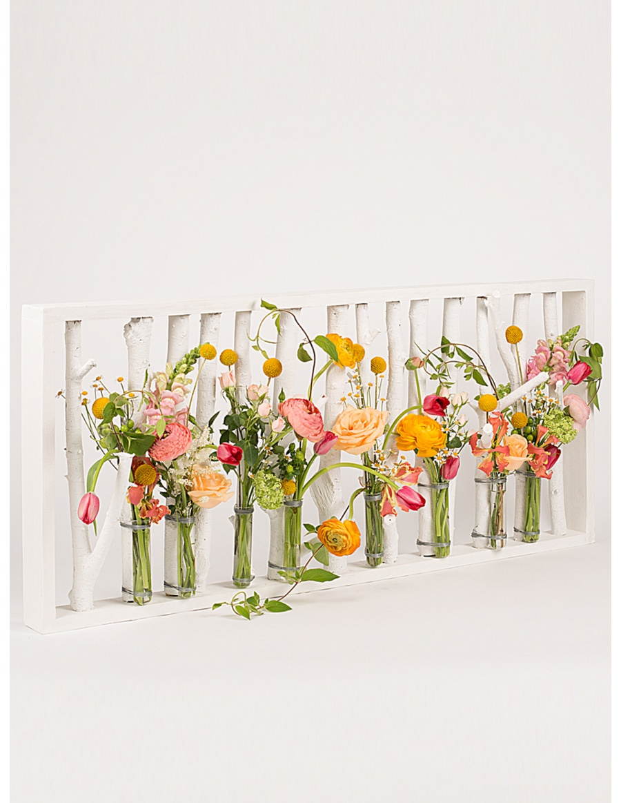 Flowers support with painted branches and test tubes