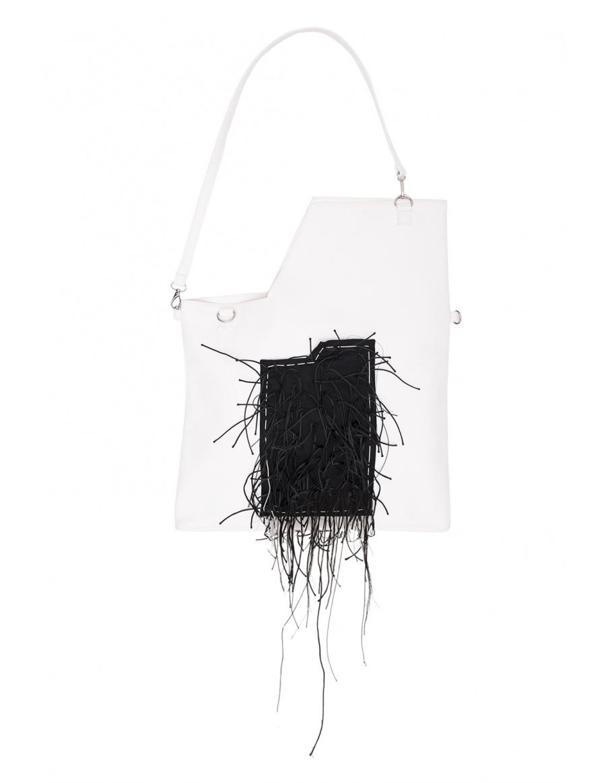 White bag with black textured pocket