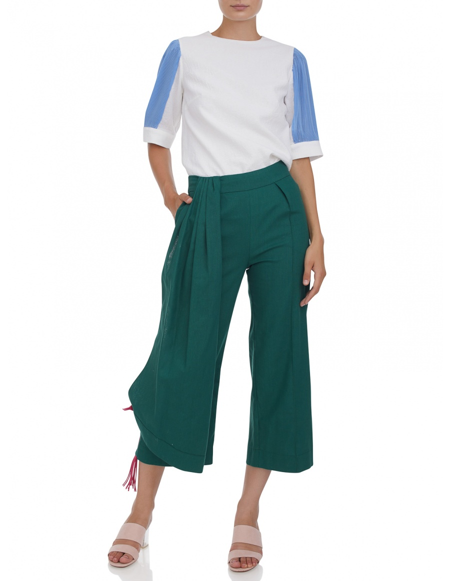 Cropped trousers with leather tassels