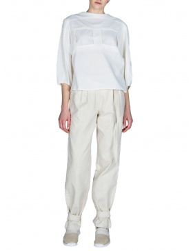 Trousers with pleats and perforated insertion