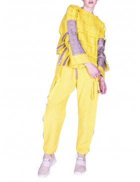 Yellow sport pants with transparent inserts